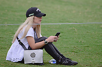 Patrick Reed's (USA) wife, Justine takes a break on 17 as her husband birdies the hole during round 1 of the Valero Texas Open, AT&amp;T Oaks Course, TPC San Antonio, San Antonio, Texas, USA. 4/20/2017.<br /> Picture: Golffile | Ken Murray<br /> <br /> <br /> All photo usage must carry mandatory copyright credit (&copy; Golffile | Ken Murray)