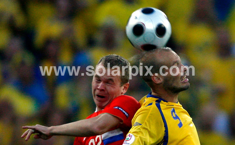 **ALL ROUND PICTURES FROM SOLARPIX.COM**.**SYNDICATION RIGHTS FOR UK AND SPAIN ONLY**.Euro 2008 European Football Championship being held in Austria/Switzerland.  Preliminary, Group D, Match 24, Russia vs Sweden, at the Tivoli-Neu Stadium, Innsbruck, Austria. 18th June 2008..This pic: Alexander Anjukow and Fredrik Ljungberg..JOB REF: 6689 CPR/Timm Schamberger       .DATE: 18_06_2008.**MUST CREDIT SOLARPIX.COM OR DOUBLE FEE WILL BE CHARGED* *UNDER NO CIRCUMSTANCES IS THIS IMAGE TO BE REPRODUCED FOR ANY ONLINE EDITION WITHOUT PRIOR PERMISSION*