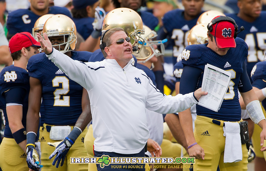 Head coach Brian Kelly yells from the sideline.