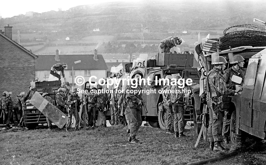 British soldiers relax during a lull in rioting in the Lenadoon housing estate, West Belfast, N Ireland. The outbreak of violence was caused by the alleged attempted take-over by Roman Catholics of nearby public housing traditionally occupied by Protestants. 9th July 1972. 197207090379f<br />