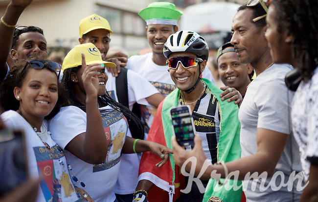 Merhawi Kudus (ERI/MTN-Qhubeka) receives a very warm welcome after finishing the stage in Gap by chanting Eritrean fans <br /> <br /> stage 16: Bourg de Péage - Gap (201km)<br /> 2015 Tour de France