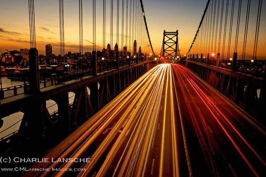 The Ben Franklin Bridge spans the Delaware river connecting Philadelphia with Camden, New Jersey. I was in Philadelphia this week on business and enjoyed exploring the city streets with my camera at night. On Monday evening after sunset I inched out to this vantage point near the second tower to make this image of vehicle lights lights crossing the bridge with the Philadelphia skyline as a background. The challenge was keeping the camera steady during a long exposure in heavy wind while avoiding detection by Philly's finest. High adventure for this country boy. March 2013. (c) Charlie Lansche, all rights reserved.