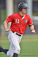 Georgia Bulldogs center fielder Stephen Wrenn (11) runs to first during a game against the Tennessee Volunteers at Lindsey Nelson Stadium March 21, 2015 in Knoxville, Tennessee. The Bulldogs defeated the Volunteers 12-7. (Tony Farlow/Four Seam Images)