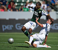 CARSON, CA - June 17, 2012: Portland Timbers forward Danny Mwanga (10) and LA Galaxy defender Todd Dunivant (2) during the LA Galaxy vs Portland Timbers match at the Home Depot Center in Carson, California. Final score LA Galaxy 1, Portland Timbers 0.