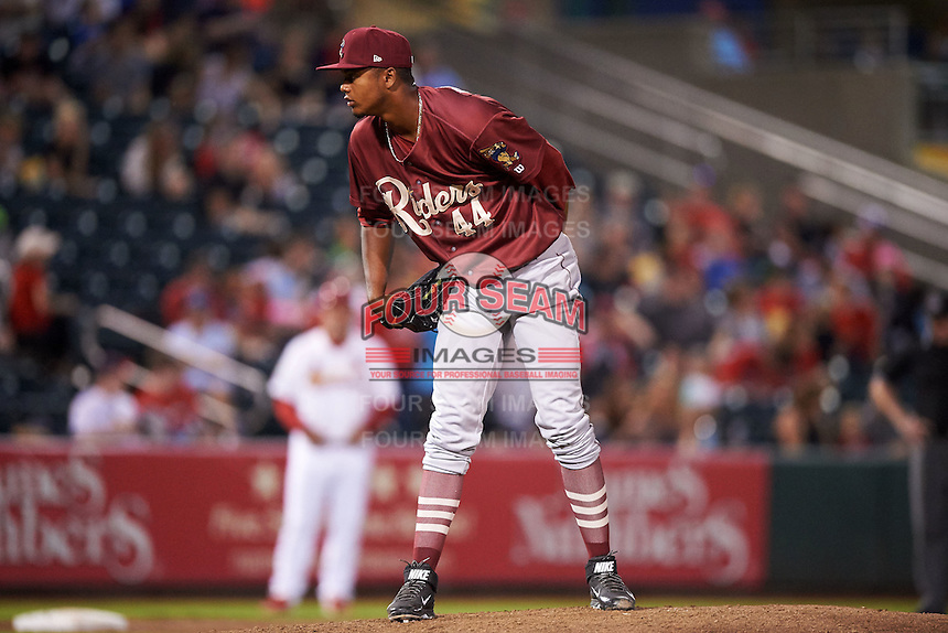 Frisco RoughRiders pitcher Victor Payano (44) looks in for the sign during a game against the Springfield Cardinals on June 3, 2015 at Hammons Field in Springfield, Missouri.  Springfield defeated Frisco 7-2.  (Mike Janes/Four Seam Images)