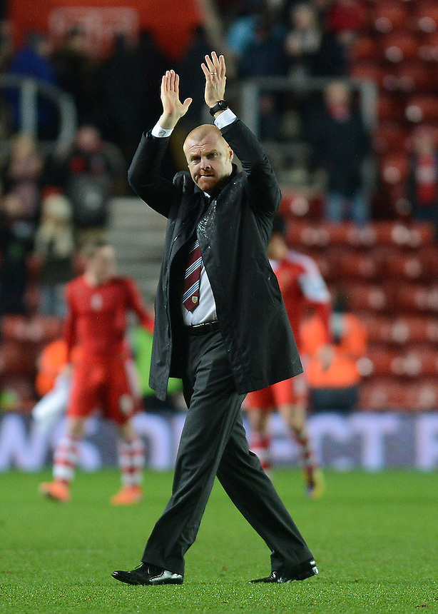 Burnley's Manager Sean Dyche applauds the travelling Burnley fans <br /> <br /> Photo by Ian Cook/CameraSport<br /> <br /> Football - FA Challenge Cup Third Round - Southampton v Burnley - Saturday 4th January 2014 - St Mary's Stadium - Southampton<br /> <br />  &copy; CameraSport - 43 Linden Ave. Countesthorpe. Leicester. England. LE8 5PG - Tel: +44 (0) 116 277 4147 - admin@camerasport.com - www.camerasport.com