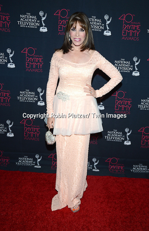 Kate Linder in peach Nathanelle dress  attends the 40th Annual Daytime Creative Arts Emmy Awards on June 14, 2013 at the Westin Bonaventure Hotel in Los Angeles, California.