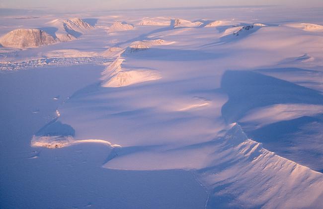 The Greenland coast & icecap in winter, northeast of Cape York. Northwest Greenland.