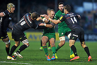 Shane Geraghty of London Irish is tackled in possession. Aviva Premiership match, between Saracens and London Irish on January 3, 2015 at Allianz Park in London, England. Photo by: Patrick Khachfe / JMP