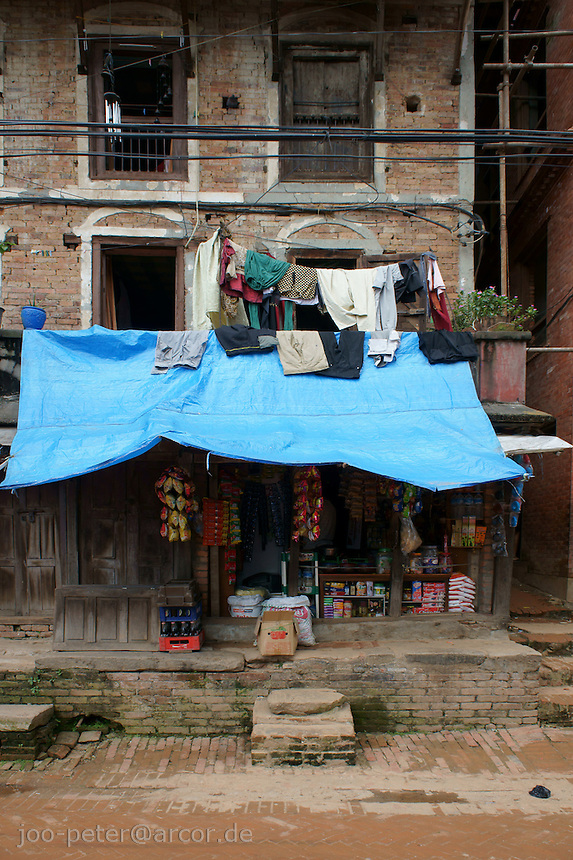 typical brick stone house in Bhaktapur, Nepal with shop in ground flor and backyard atmosphere