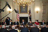 """United States President Barack Obama, center, speaks while meeting with members of the Democratic Governors Association in the State Dining Room with John Podesta, counselor to Obama, from left, David Simas, assistant to Obama, U.S. Vice President Joseph """"Joe"""" Biden, Valerie Jarrett, senior advisor to Obama, Cecilia Munoz, director of the White House Domestic Policy Council, and Gene Sperling, director of the National Economic Council (NEC), in Washington, D.C., U.S., on Friday, Feb. 21, 2014. Obama will emphasize Democratic priorities in his next budget, dropping an offer to trim the growth of entitlement spending and proposing new tax limits for U.S.-based multi-national companies. <br /> Credit: Andrew Harrer / Pool via CNP"""