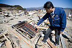 Michihiro Kohno, president of soy sauce and miso soup maker Yagisawa Shoten, looks at the 200-year-old safe that he searched for to find the historical document that proves his family business' 207-year-old heritage in Rikuzentakata, Iwate Prefecture, Japan on 06 April, 2011. .Photographer: Robert Gilhooly