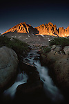 A waterfall flows in Dusy Basin, Kings Canyon National Park, California.
