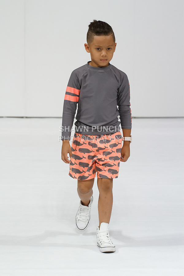 Child model walks runway during the petitePARADE Spring Summer 2018 fashion show with Children's Club, at the Javits Center on August 6, 2017.