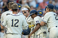 Michigan Wolverines catcher Joe Donovan (0) celebrates after his eighth inning home run against the Vanderbilt Commodores during Game 1 of the NCAA College World Series Finals on June 24, 2019 at TD Ameritrade Park in Omaha, Nebraska. Michigan defeated Vanderbilt 7-4. (Andrew Woolley/Four Seam Images)