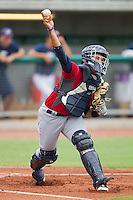 Catcher Elvin Soto #20 makes a throw to first base during infield practice at the USA Baseball 18U National Team Trials at the USA Baseball National Training Center on June 30, 2010, in Cary, North Carolina.  Photo by Brian Westerholt / Four Seam Images