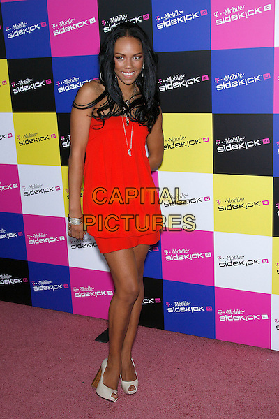 KIELY WILLIAMS of THE CHEETAH GIRLS .Attending the T-Mobile Sidekick iD Launch, .held at the T-Mobile Sidekick Lot,  Los Angeles, California, USA,13 April 2007..full length red mini dress.CAP/ADM/ZL.©Zach Lipp/AdMedia/Capital Pictures.