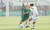 Lori Chalupny (green) take son Stephanie Coix...Saint Louis Athletica and LA Sol, played to a 0-0 tie at Robert Hermann Stadium in St Louis, MO. April 25 2009.