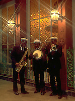 Street scene at night of jazz musicians in the French Quarter. New Orleans, Louisiana.