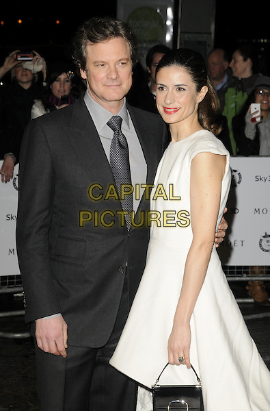 COLIN FIRTH & LIVIA GIUGGIOLI.London Critics' Circle Film Awards at BFI Southbank, London, England..February 10th 2011.ALFS half length black white suit sleeveless dress married husband wife handbag side.CAP/CAN.©Can Nguyen/Capital Pictures.