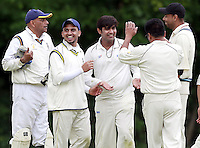 Mehul Gokhani (C) is congratulated by his team mates after taking eight wickets for Harrow Town during the ECB Middlesex Division Three game between Highgate and Harrow Town at Park Road, Crouch End on Saturday May 24, 2014