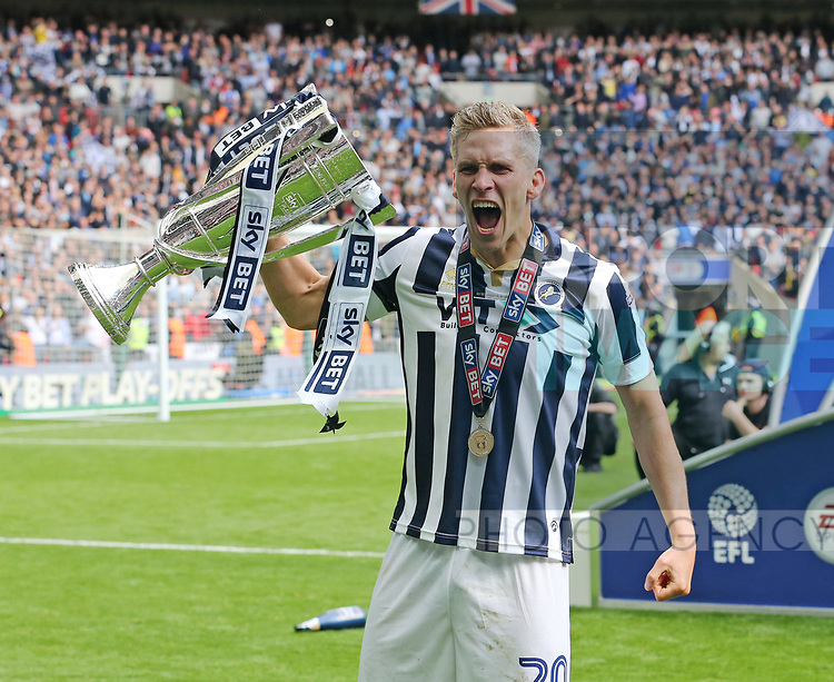 Millwall's Steve Morison celebrates with the trophy during the League One Play-Off Final match at Wembley Stadium, London. Picture date: May 20th, 2017. Pic credit should read: David Klein/Sportimage