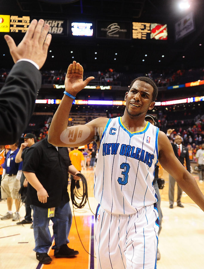 Mar. 25, 2011; Phoenix, AZ, USA; New Orleans Hornets guard Chris Paul celebrates following the game against the Phoenix Suns at the US Airways Center. The Hornets defeated the Suns 106-100. Mandatory Credit: Mark J. Rebilas-