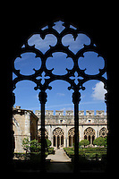 View through 13th century tracery on to the cloister's courtyard in the Monestir de Santes Creus, Aiguamurcia, Catalonia, Spain, pictured in May 21, 2006, in the morning. The Cistercian Reial Monestir Santa Maria de Santes Creus and its church were built between 1174 and 1225. Following strict Cistercian rule, the Romanesque complex originally featured no architectural embellishments with the exception of ornamented capitals and crenellations on the rooflines. In the 13th century the cloister was converted in Gothic style by James II of Aragon. The Lavabo, seen on the left, was not altered and remains of the first Romanesque cloister. Picture by Manuel Cohen.