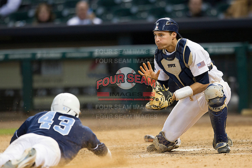 Rice Owls catcher Geoff Perrot #28 prepares to catch a throw as Korey Dunbar #43 slides towards the plate in the eighth inning of the NCAA baseball game against the North Carolina Tar Heels on March 1st, 2013 at Minute Maid Park in Houston, Texas. North Carolina defeated Rice 2-1. (Andrew Woolley/Four Seam Images).