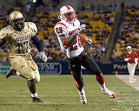 Louisville Cardinals wide receiver JaJuan Spillman (26) outruns Pitt linebacker Clint Session (17) to score on a 13-yard touchdown run.  The Louisville Cardinals defeated the Pitt Panthers 48-24 on November 25, 2006 at Heinz Field, Pittsburgh, Pennsylvania.