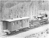 D&amp;RG American-type engine with express car #150 posing with her crew on Marshall Pass.<br /> D&amp;RG  Marshall Pass, CO  Taken by Jackson, William Henry - 1880-1888