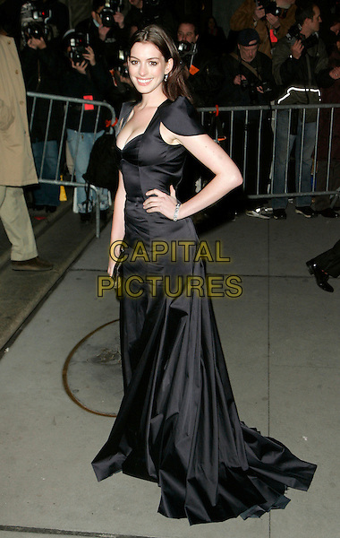 "ANNE HATHAWAY.At Fashion Group International 23rd Annual Night of Stars Honoring ""The Visionaries"" at Cipriani 42nd, New York, New York, USA..October 26th, 2006.Ref: ADM/JL.full length black dress gown hand on hip.www.capitalpictures.com.sales@capitalpictures.com.©Jackson Lee/AdMedia/Capital Pictures."