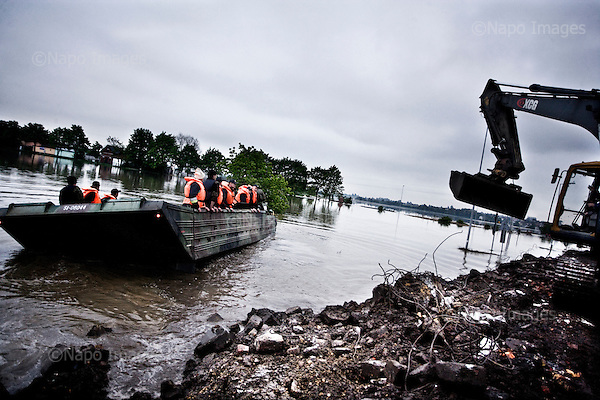 Kedzierzyn Kozle 22.05.2010 Poland<br /> In Kedzierzyn Kozle (south-west Poland ) the river Odra interrupted shafts. The whole city was flooded. tens of thousands remained without electricity and contact with the outside world.<br /> Arround 5 billion euros loss, hundreds of thousands of victims, environmental pollution. This is only the initial losses of the great flood in Poland.<br /> Photo: Adam Lach / Napo Images<br /> <br /> Wielka powodz w Polsce. W Kedzierzynie-Kozlu rzeka Odra przerwala waly. Niemal cale miasto zostalo zalane. Tysiace ludzi zostalo pozbawionych pradu i kontaktu ze swiatem zewnetrznym.<br /> Fot: Adam Lach / Napo Images