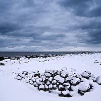 Old stone wall in winter, near Kvalness, Vestvågøy, Lofoten islands, Norway