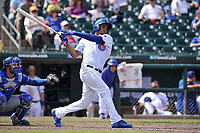 Iowa Cubs first baseman Jeimer Candelario (35) swings during a  game against the Round Rock Express at Principal Park on April 16, 2017 in Des  Moines, Iowa.  The Cubs won 6-3.  (Dennis Hubbard/Four Seam Images)