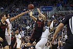 San Diego State guard Malachi Flynn (22)shoots over Nevada guard Jazz Johnson (22)  during the first half of a basketball game played at Lawlor Events Center in Reno, Nev., Saturday, Feb. 29, 2020. (AP Photo/Tom R. Smedes)