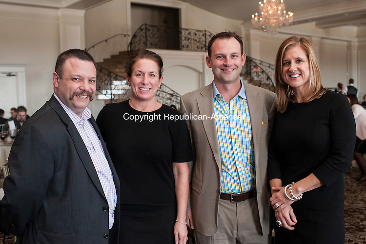 PROSPECT, CT-25 March 2015-032515EC23-  Social Moments. Frank Monteiro with MacDermid, Inc., Karen Senich, the Executive Director of the Waterbury Boys and Girls Club, Brandon Dufour, with All-Star Driver, and Kristen Jacoby, the President of the United Way of Greater Waterbury attend the 125th annual meeting of the Greater Waterbury Chamber of Commerce, held March 24 at Aria Banquet Facility in Prospect. Erin Covey Republican-American