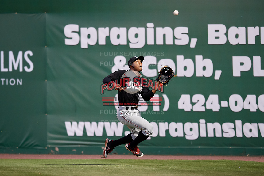 Chattanooga Lookouts right fielder Edgar Corcino (11) tracks a fly ball during a game against the Jackson Generals on April 29, 2017 at The Ballpark at Jackson in Jackson, Tennessee.  Jackson defeated Chattanooga 7-4.  (Mike Janes/Four Seam Images)