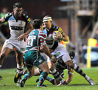 Leicester, England. Mike Brown of Harlequins tackled during the Aviva Premiership match between Leicester Tigers and Harlequins at Welford Road on September 22, 2012 in Leicester, England.