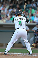 Dayton Dragons catcher Yovan Gonzalez #4 bats during a game against the Lake County Captains at Fifth Third Field on June 25, 2012 in Dayton, Ohio. Lake County defeated Dayton 8-3. (Brace Hemmelgarn/Four Seam Images)