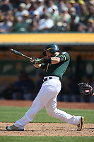 OAKLAND, CA - AUGUST 15:  Jonathan Lucroy #21 of the Oakland Athletics bats against the Seattle Mariners during the game at the Oakland Coliseum on Wednesday, August 15, 2018 in Oakland, California. (Photo by Brad Mangin)