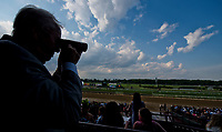ELMONT, NY - JUNE 10: Fan uses binoculars to watch the race on Belmont Stakes Day at Belmont Park on June 10, 2017 in Elmont, New York (Photo by Scott Serio/Eclipse Sportswire/Getty Images)