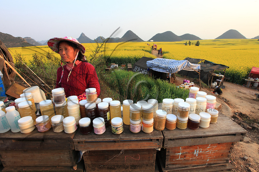 Luoping, Yunnan. The beekeepers offer all the wealth from the hives to the city tourists who discover royal jelly, pollen and different honeys. The most prized is the rape flower honey harvested in front of them.