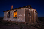 A moonlit night at the abandoned Lone Wolf Annex building located along historic Route 66, near Joseph City, Arizona