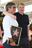 LOS ANGELES - AUG 22:  Simon Cowell, Rob Stringer at the Simon Cowell Star Ceremony on the Hollywood Walk of Fame on August 22, 2018 in Los Angeles, CA