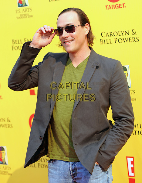 CHRIS KLEIN .at The 2008 P.S. Arts' Express Yourself sponsored by Target held at Barker Hangar in Santa Monica, California, USA,  November 16th 2008.                                                                     .half length grey gray suit jacket green top  sunglasses hand touching.CAP/DVS.©Debbie VanStory/Capital Pictures