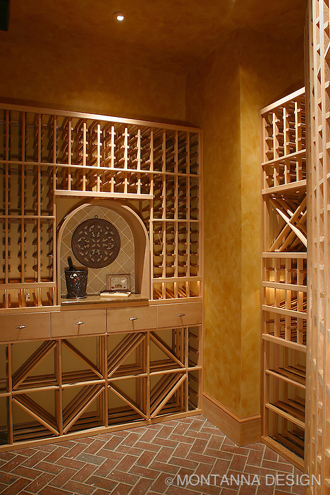Classic Wine Cellar with herringbone brick tile flooring