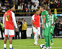BOGOTA-COLOMBIA, 17-10-2019: Ronaldinho Gaucho ex jugador brasileño Ronaldinho Gaucho y Víctor Aristizábal ex jugador colombiano, durante un partido de exhibición entre Independiente Santa Fe y Atlético Nacional en el estadio Nemesio Camacho El Campín en la ciudad de Bogotá. / Ronaldinho Gaucho Brazilian former player and Victor Aristizábal Colombian former player during an exhibition match between Independiente Santa Fe and Atlético Nacional at the Nemesio Camacho El Campín stadium in the city of Bogota./ Photo: VizzorImage / Luis Ramírez / Staff.