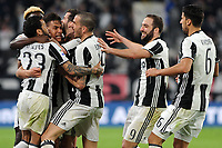 Calcio, Serie A: Juventus vs Milan. Torino, Juventus Stadium, 10 marzo 2017.<br /> Juventus&rsquo; Paulo Dybala, second from left, celebrates with his teammates after scoring on a penalty kick the winning goal during the Italian Serie A football match between Juventus and AC Milan at Turin's Juventus Stadium, 10 March 2017. Juventus won 2-1.<br /> UPDATE IMAGES PRESS/Manuela Viganti