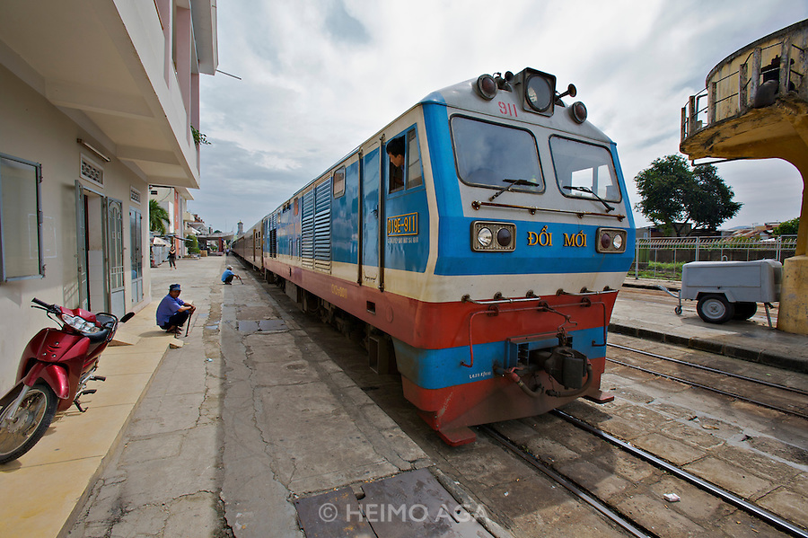 """The """"5-Star-Train"""" departing to Ho Chi Minh City (Saigon). The locomotive sports the inscription """"Doi Moi"""" - the slogan that started Vietnam's opening towards capitalism."""